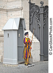 Swiss guard - VATICAN CITY, ITALY - MARCH 23: A Papal Swiss...