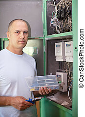 Man working with electrical shield