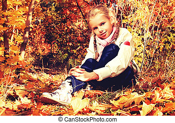 leafage - Portrait of a cute little girl posing at the...