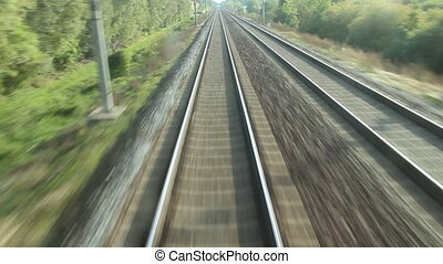 Rail - train passing through countryside, moving railroad...