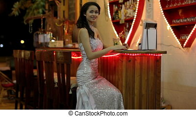 gorgeous asian woman alone at bar