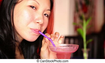Asian young woman drink cocktail