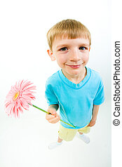 Cutie - Vertical photo of joyful child holding pink flower...