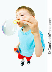 Child with soap bubbles - Portrait of cute child blowing...