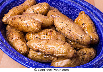 Dish of fingerling potatoes baked in oven - Blue dish with...