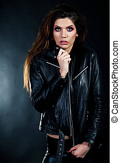 Attractive young girl brunette in black leather jacket -...