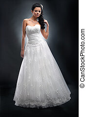 Luxurious young woman fiancee in white wedding dress -...