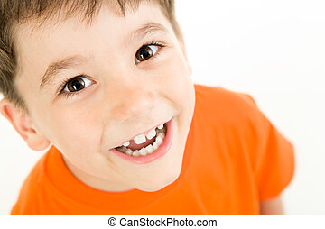 Happy boy - Portrait of happy boy laughing on a white...