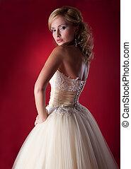 Bride fashion model in white bridal dress posing in studio