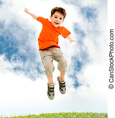 Leap - Photo of young boy jumping and raising hands in...