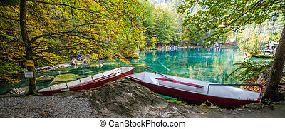 Red boats by the lake - Autumn at Blausee, Switzerland