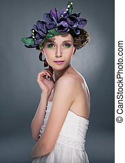 Sensual fashion model pretty girl in wreath of flowers...