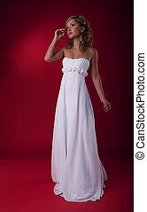 Bride fashion model in brldal dress on podium