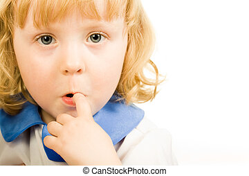 Grimace - Portrait of cute little girl putting her finger to...