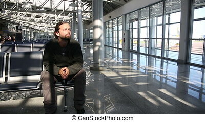 young man waiting his flight