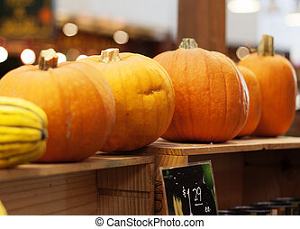 pumpkins on shelf at granville island market