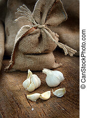 ripe garlic -  jute sack with ripe garlic  on wooden board