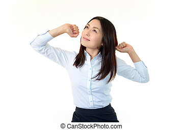 Business woman doing stretching - Young business woman doing...