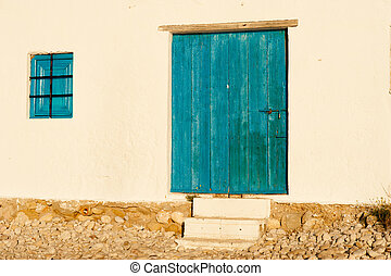 Mediterranean architecture - Blue wood on whitewashed wall,...