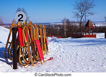 Wooden sleds   - Wooden sleds in the ski resort