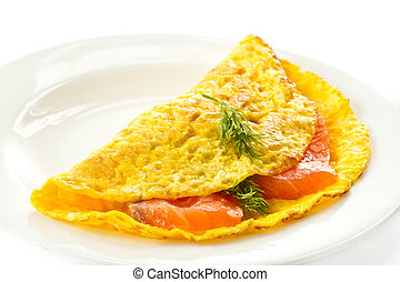 omelette - scrambled eggs with salted salmon on a plate