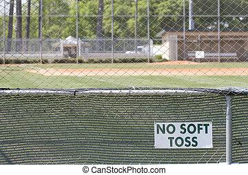 No Soft Toss - Sign on a public softball field no soft toss