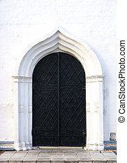 old black iron church door