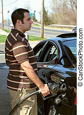 High Gas Prices - A man pumping high priced gas into his car...