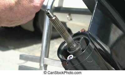 applying grease to prop shaft - New Zealand Marine mechanic...