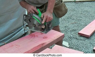 Cutting timber with a circular saw - New Zealand close up of...