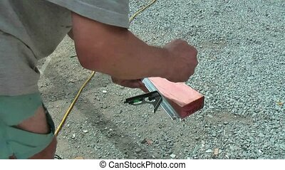 Carpenter using a builders square. - New Zealand. Carpenter...