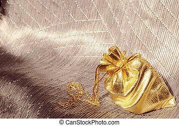 Gift bag with gold chain on elegant background