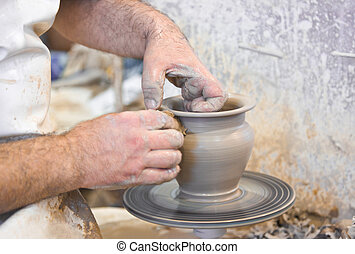 Potter hands and wheel