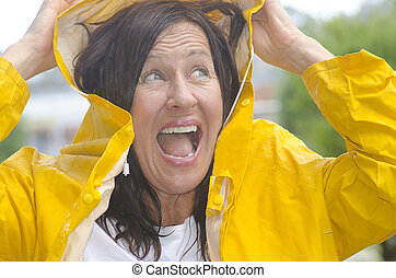 Happy smiling woman in rain - Portrait mature woman standing...