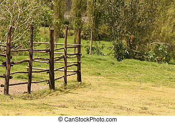 Wood Fence in a Farmers Field - A wooden fence stretching...