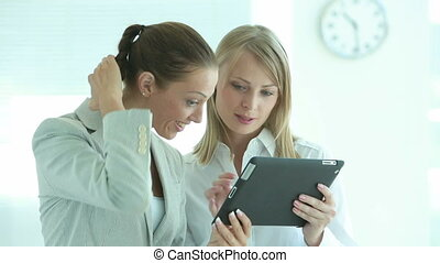 Business friends - Lively businesswomen choosing the most...