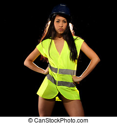 Sexy woman with safety jacket or vest and helmet