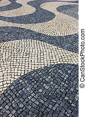 Detail of a typical portuguese pavement at Lisbon, Portugal