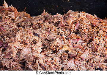 Pulled Pork - Pulled pork being cooked on a barbecue grill