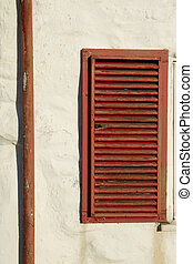 Shutter and pipe - A rustic wooden, brown painted, window...