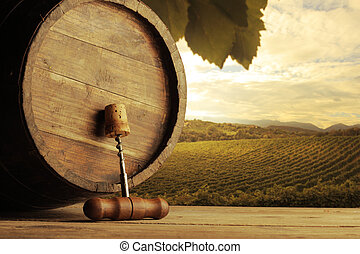 Vineyard - corkscrew and wooden barrel, vineyard on...
