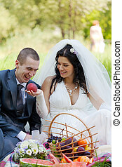 bride treats the groom with a ripe peach