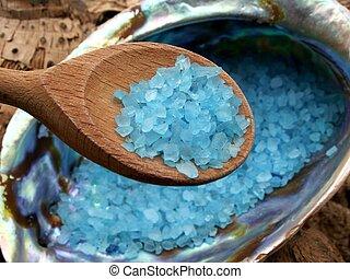 Bathsalt crystals in the seashell - Spoon full of blue bath...