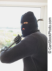 Robber holding a crowbar in his hands - Robber winding up a...