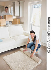 Two young people furnishing the house - Two people...