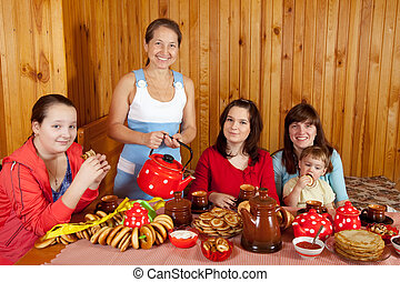 family drinking tea with russian snack - Happy family...