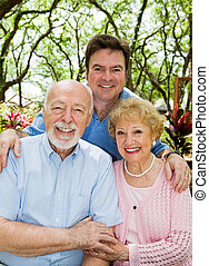 Adult Son and Elderly Parents - Adult son with his elderly...
