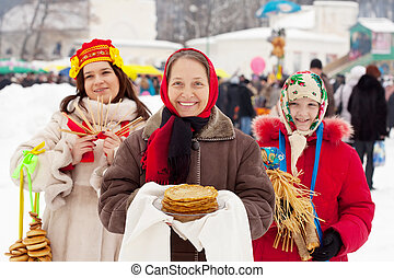 women celebrating Shrovetide - happy women celebrating...