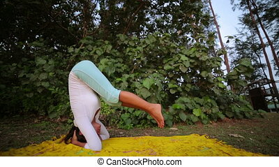 doing handstand yoga mediatation exercise