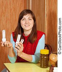 Girl holding energy saving  bulbs
